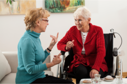 a lady talking to an old woman