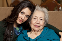 a lady comforting an old woman